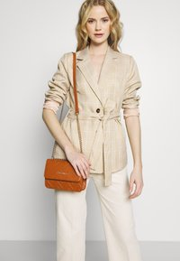 Valentino by Mario Valentino - FAUNO - Across body bag - tan - 1