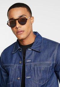 Alexander McQueen - Sluneční brýle - havana brown - 1