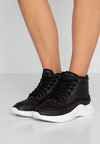 Calvin Klein - UDA - High-top trainers - black - 0