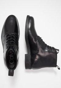 Calvin Klein - FORDEN LACE UP BOOTIE - Nauhalliset nilkkurit - black - 1