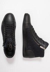 Calvin Klein - BERKE EMBOS - Korkeavartiset tennarit - black - 1