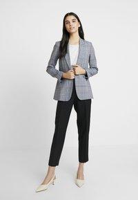 Calvin Klein - UNIFORM TWILL CIGARETTE PANT - Trousers - black - 1
