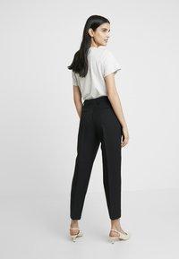 Calvin Klein - UNIFORM TWILL CIGARETTE PANT - Trousers - black - 2
