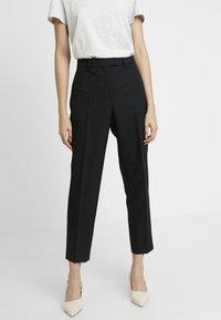 Calvin Klein - UNIFORM TWILL CIGARETTE PANT - Trousers - black - 0