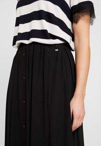Calvin Klein - BUTTON THROUGH SKIRT - A-line skirt - black - 4