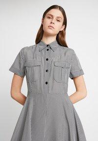 Calvin Klein - STRONG GINGHAM DRESS - Blousejurk - black/white - 3