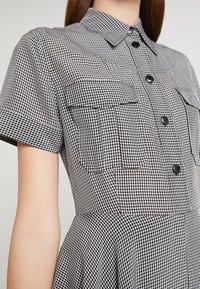 Calvin Klein - STRONG GINGHAM DRESS - Blousejurk - black/white - 6