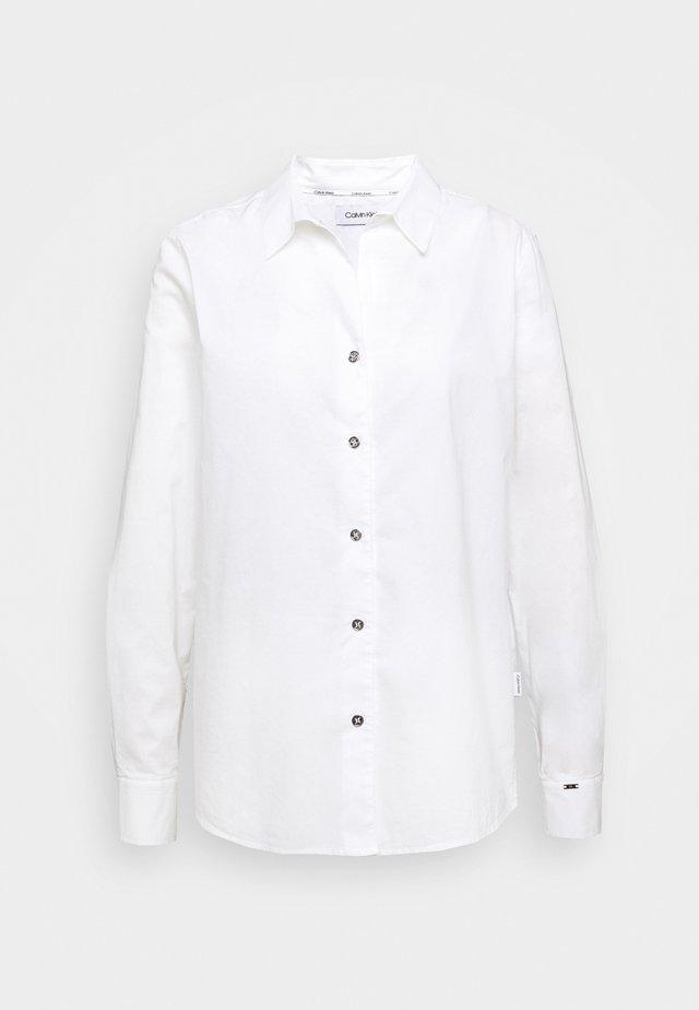 OPEN NECK SHI YAF - Button-down blouse - white