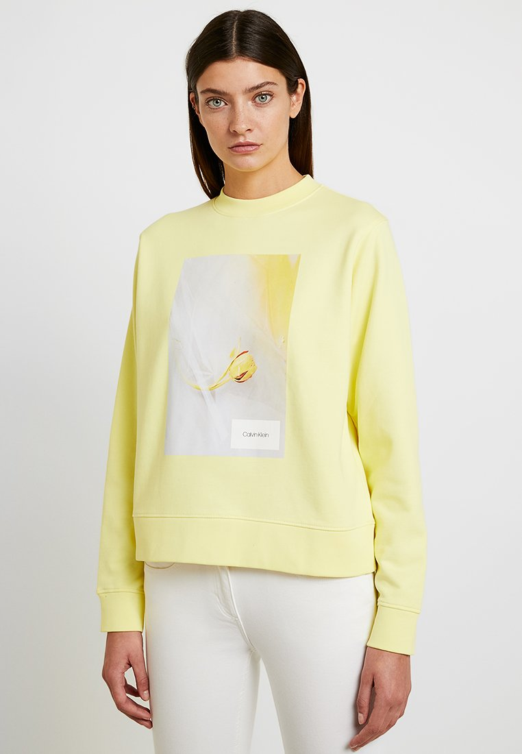Calvin Klein - GRAPHIC FLOWER - Sweatshirt - yellow