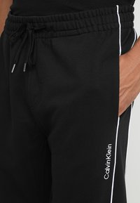 Calvin Klein - EMBROIDERY PANT - Tracksuit bottoms - black - 4
