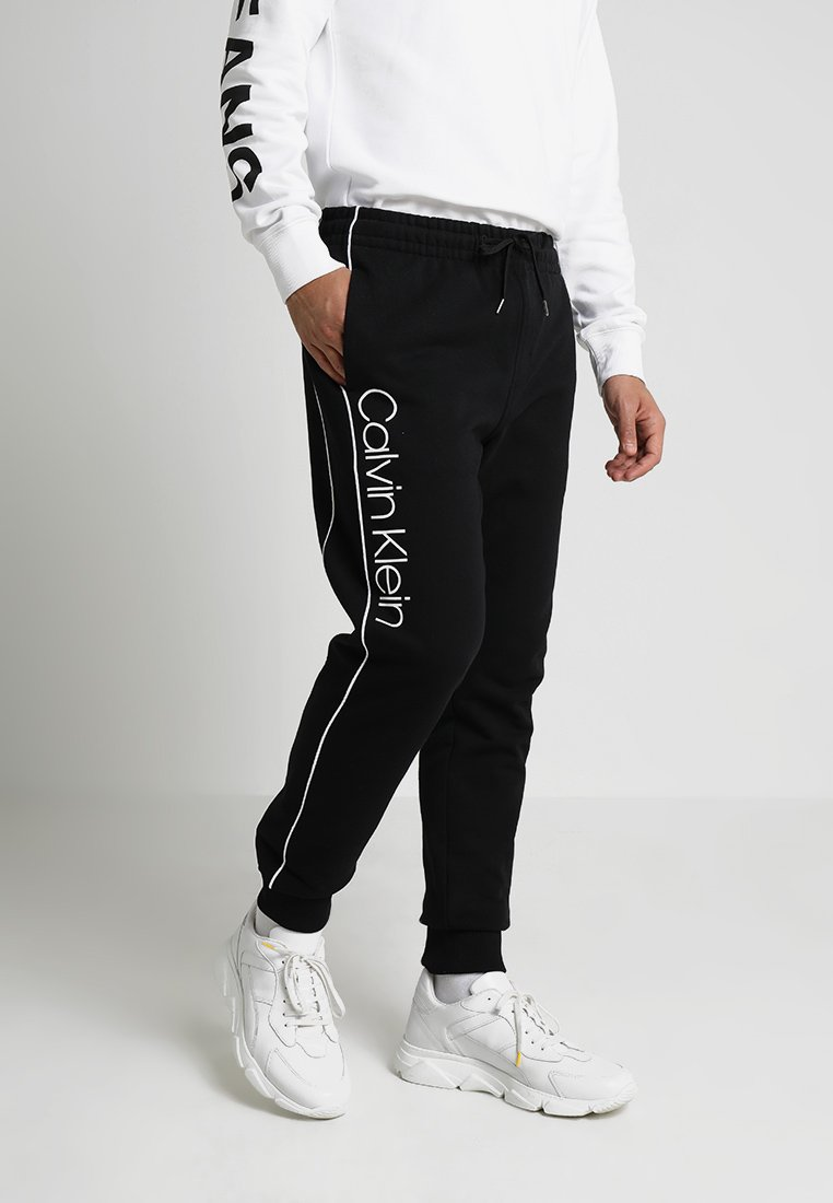 Calvin Klein - LOGO PRINT - Tracksuit bottoms - perfect black