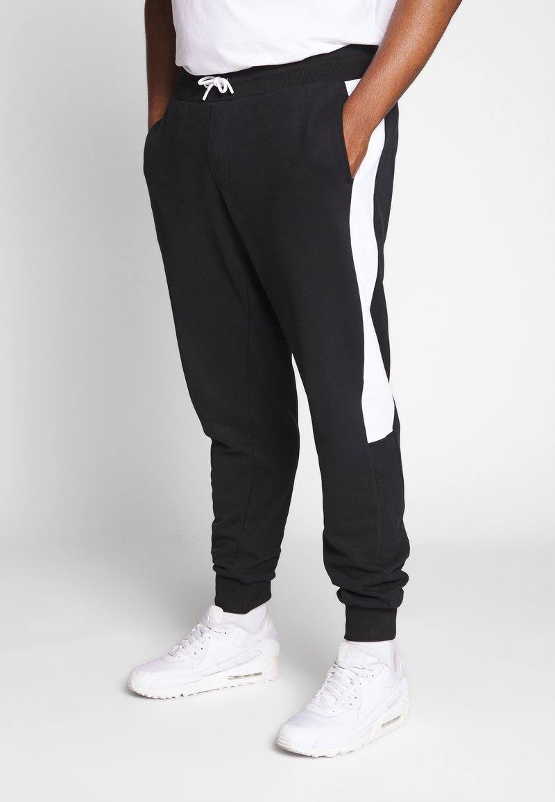 Calvin Klein - LOGO STRIPE  - Tracksuit bottoms - black