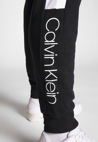 Calvin Klein - LOGO STRIPE  - Tracksuit bottoms - black - 3