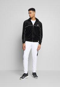 Calvin Klein - OGO STRIPE  - Trainingsbroek - white - 1