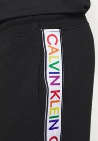 Calvin Klein - PRIDE  - Tracksuit bottoms - black - 4