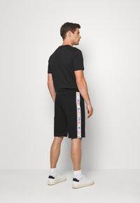 Calvin Klein - PRIDE  - Tracksuit bottoms - black - 2