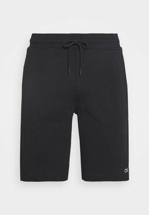 PRIDE  - Tracksuit bottoms - black