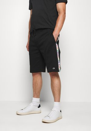 PRIDE  - Tracksuit bottoms - black