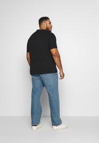 Calvin Klein - CARBON BRUSH LOGO  - Print T-shirt - black - 2