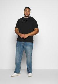 Calvin Klein - CARBON BRUSH LOGO  - Print T-shirt - black - 1
