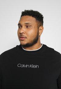 Calvin Klein - CARBON BRUSH LOGO  - Print T-shirt - black - 4