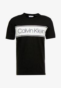 Calvin Klein - FRONT STRIPE LOGO - Print T-shirt - black - 3