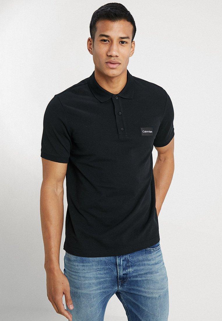 Calvin Klein - REFINED LOGO BADGE - Polo shirt - black