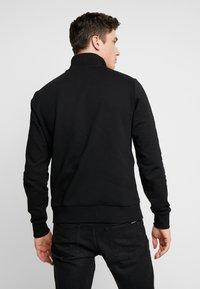 Calvin Klein - COLOR BLOCK LOGO ZIP MOCK - Bluza rozpinana - black - 2