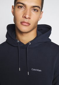 Calvin Klein - LOGO EMBROIDERY HOODIE - Huppari - blue - 5