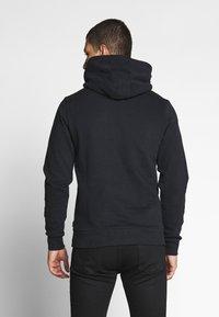 Calvin Klein - LOGO EMBROIDERY HOODIE - Sweat à capuche - black - 2