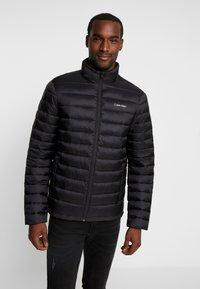 Calvin Klein - LIGHT LINER - Light jacket - black - 0