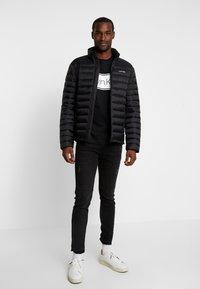 Calvin Klein - LIGHT LINER - Chaqueta de entretiempo - black - 1
