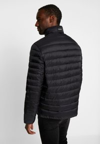 Calvin Klein - LIGHT LINER - Light jacket - black - 2