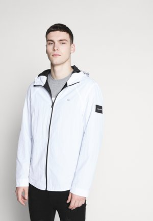 CRINKLE HOODED WINDCHEATER - Summer jacket - white