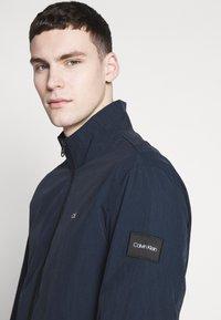 Calvin Klein - CRINKLE BLOUSON JACKET - Summer jacket - blue - 5