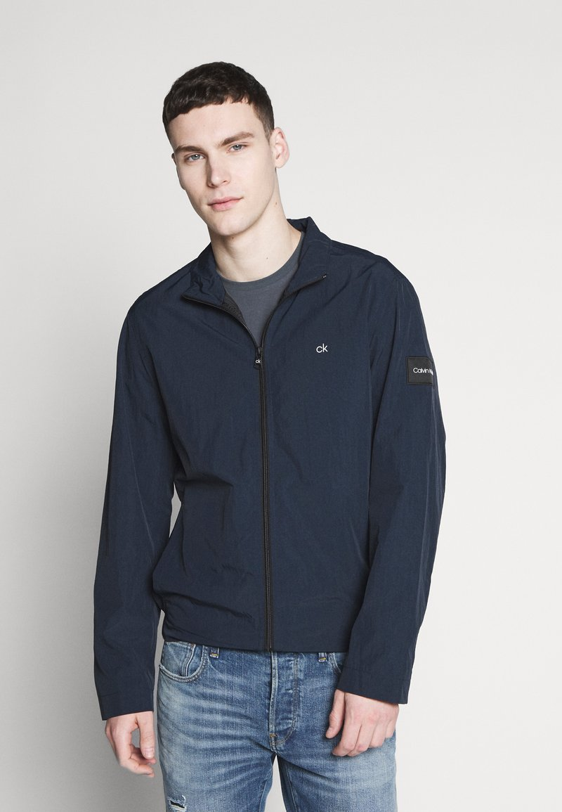 Calvin Klein - CRINKLE BLOUSON JACKET - Summer jacket - blue