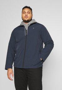 Calvin Klein - CRINKLE JACKET - Summer jacket - blue - 0