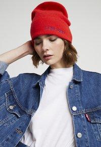 Calvin Klein - BOILED BEANIE - Čepice - red - 1