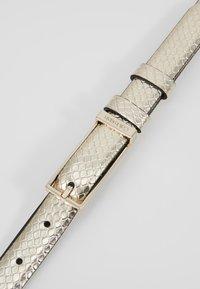 Calvin Klein - WINGED BELT - Belt - beige - 4