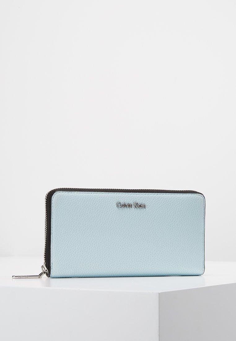 Calvin Klein - NEAT LARGE ZIPAROUND - Portfel - blue