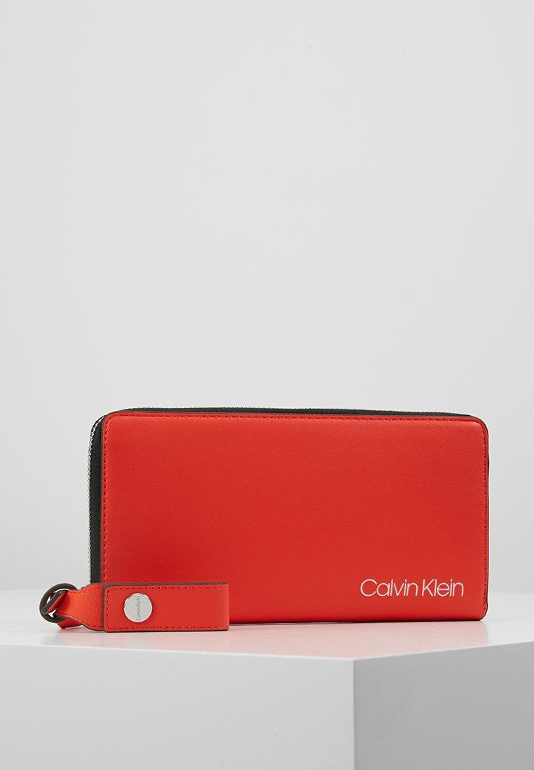 Calvin Klein - STRIDE ZIPAROUND - Portefeuille - orange