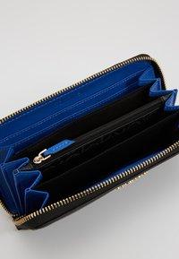 Calvin Klein - MUST LARGE ZIPAROUND - Wallet - black - 5