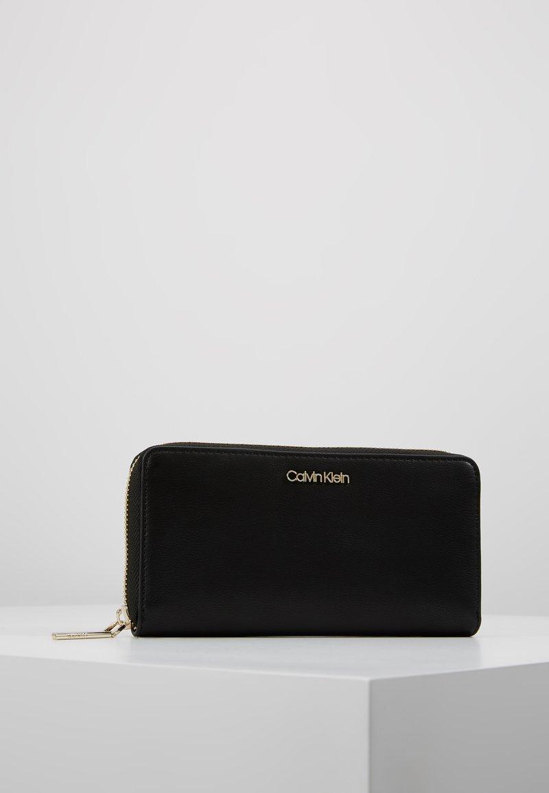 Calvin Klein - MUST LARGE ZIPAROUND - Portefeuille - black