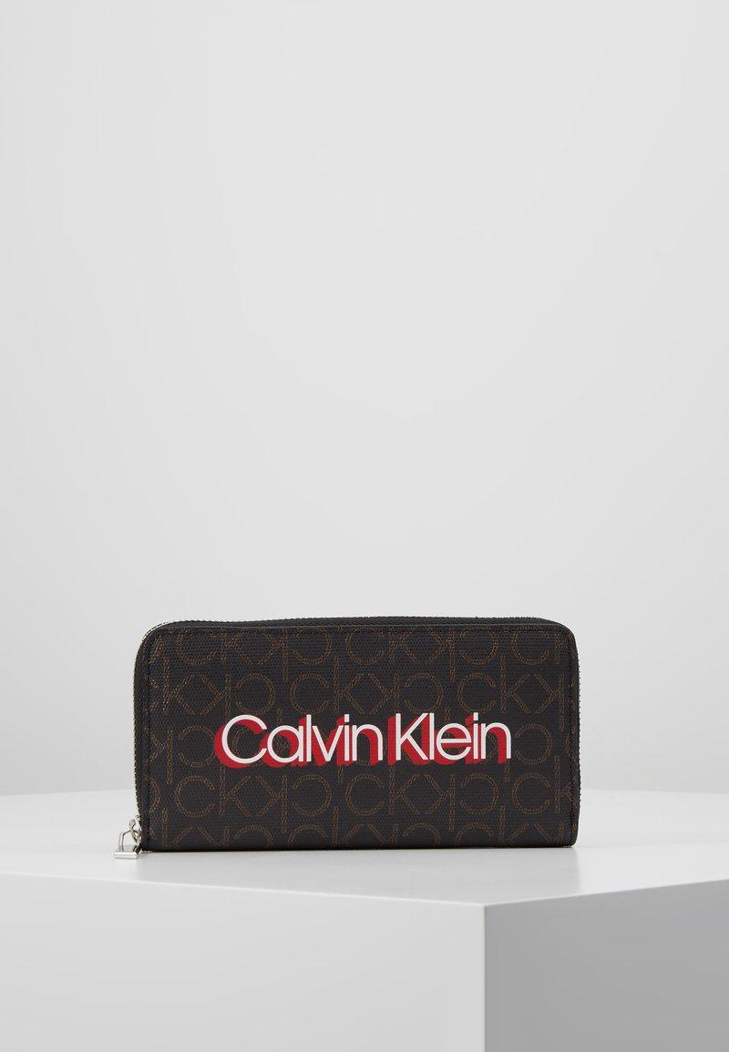 Calvin Klein - MONOGRAM ZIPAROUND - Portefeuille - brown