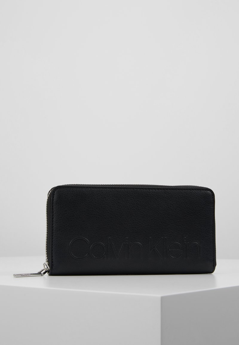 Calvin Klein - RAPID LARGE ZIP AROUND - Geldbörse - black