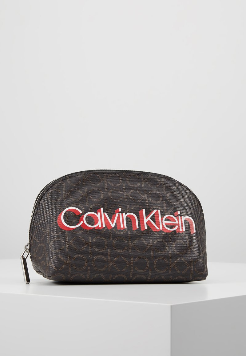Calvin Klein - MONOGRAM MAKE UP BAG - Wash bag - brown