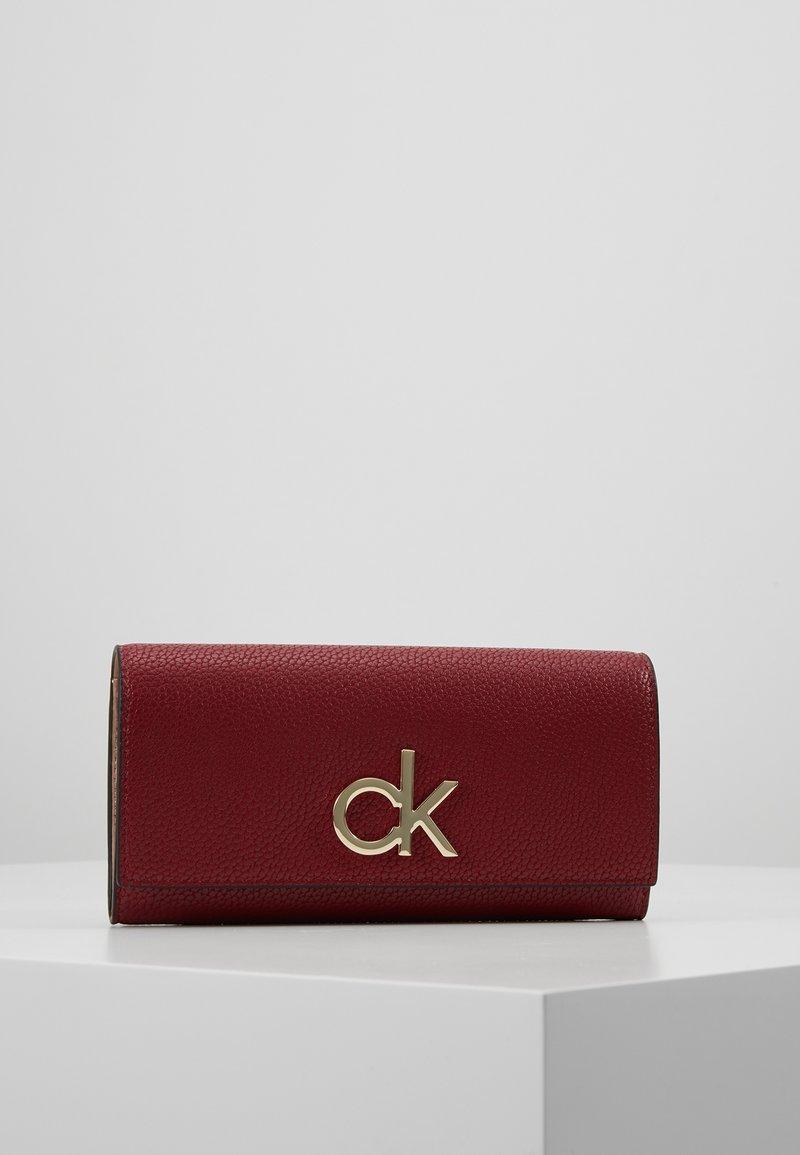 Calvin Klein - RE LOCK TRIFOLD - Portfel - red