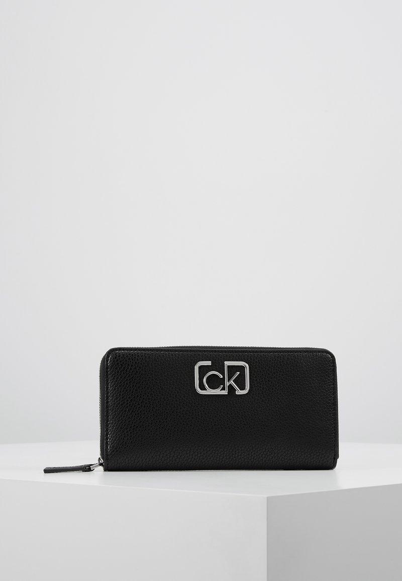 Calvin Klein - SIGNATURE ZIPAROUND - Lommebok - black