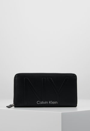 SHAPED ZIPAROUND - Wallet - black