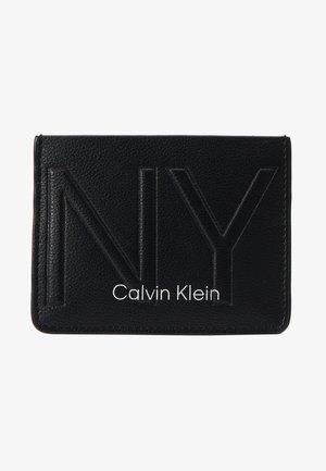 NY SHAPED HOLDER - Wallet - black